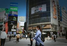 Japan's economy contracted less than earlier announced
